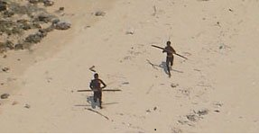 Sentinelese men aiming arrows at helicopter